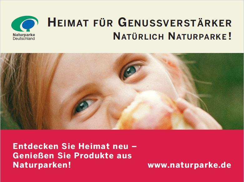 Anzeige Heimat für Genussverstärker: Ein Mädchen beißt in einen Apfel und schaut in die Kamera